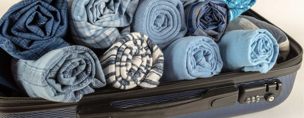 clothes roll the professional traveller packing hacks #theprofessionaltraveller